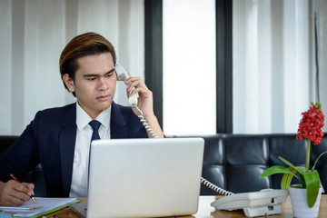 Businessman talking on the phone while working.