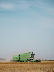 Serbia, Vojvodina, Combine harvester in soybean field