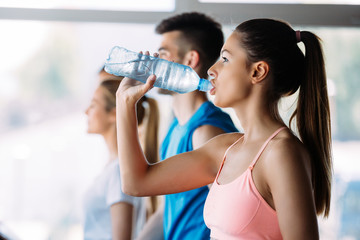 Sporty woman hydrating during workout