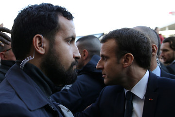 Elysee senior security officer Alexandre Benalla stands next to French President Emmanuel Macron during a visit to the Paris International Agricultural Show in Paris