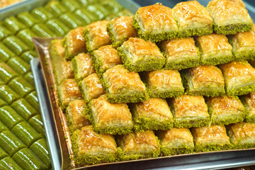Traditional, delicious Turkish baklava and green pistachio nut sarma .