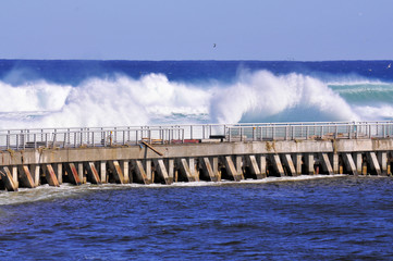 Crashing Surf / Waves and storm surge crashing against the seawall at the Ocean Inlet near Boynton Beach, Florida