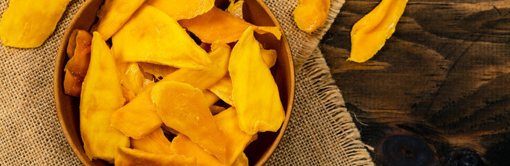 Dried Mango Fruit on Old Wooden Background. Selective focus.