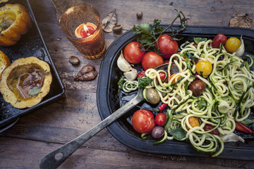 Pasta with herbs and tomatoes and roast squash