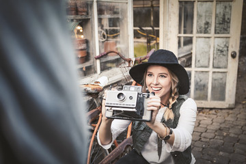 Woman taking a photo with vintage camera