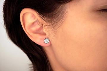 Woman wearing amazing earrings with diamonds