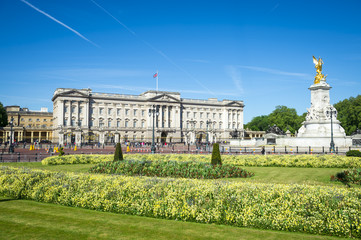 View across flower beds in front of Buckingham Palace.