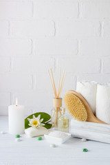 Spa treatment  - towels aromatic soap, bath salt, and oil, and accessories for massage and bathroom.