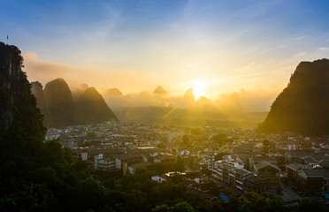 Sunrise in Yangshuo China over the karst rocks and city