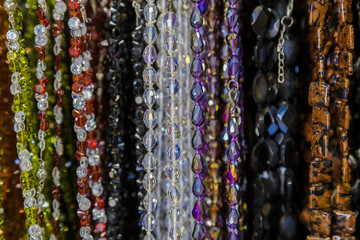 beautiful multicolor beads in necklace form, marvelous colorful beads in necklace form as background, texture.