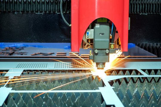 Close-up a laser cutting machine is working with a steel plate until it sparks on smart factory, industry 4.0