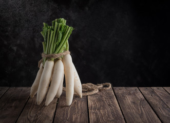 White radish on wood
