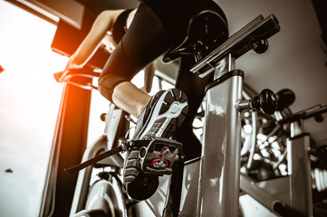 Fitness woman working out on exercise bike at the gym.exercising concept.fitness and healthy...