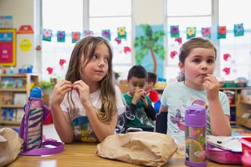 Students having a snack in a kindergarten classroom.