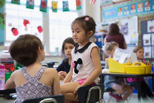Students in a kindergarten classroom.