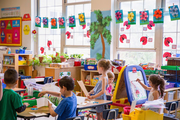 Students working in a kindergarten classroom.