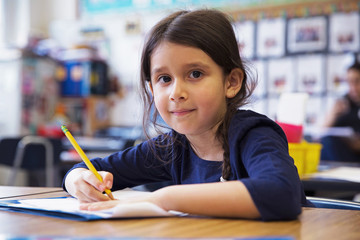 A student in a kindergarten classroom.