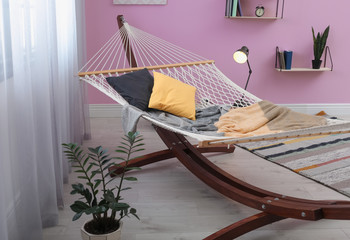 Stylish living room interior with comfortable hammock