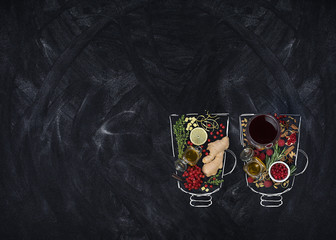 Ingredients for winter drinks (mulled wine, punch, tea): apples, orange, lemon and spices on a dark background. view from above.