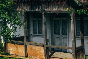 beautiful rustic wooden old building in sunny garden, exploring country, abandoned life, travel concept