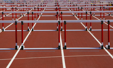 Hurdles on competition background