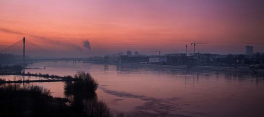 Panorama of Warsaw with the Swietokrzyski bridge in the morning fog of a smoky city