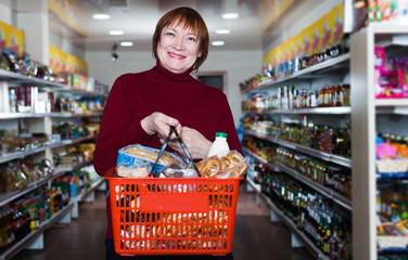 consumer in the supermarket choosing food with basket