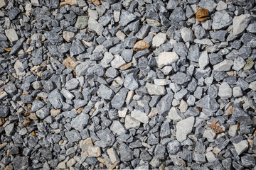 the continuous space filled with  granite gravel texture , White pebbles stone background, gravel stone wallpaper, landscape concept pattern .