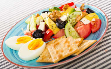 Vitamin salad with boiled egg and crackers