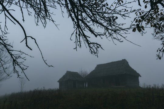 Landscape with alone old house on foggy meadow. Can be used like Halloween background. Located place: Carpathians, Europe