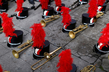 Marching band instruments are seen on a curb prior to participate in the opening parade of the festivities of El Divino Salvador del Mundo (The Divine Savior of The World), patron saint of the capital city of San Salvador