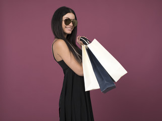 Happy brunette woman with some shopping bags