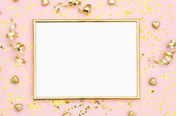 Photo frame mock up with space for text, golden sequins confetti on pink background. Lay Flat, top view. Valentine's minimal flatly background.