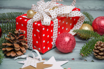 Red luxury New Year gift. Christmas gift. Happy New Year 2017. Christmas background with gift box. Christmastime celebration