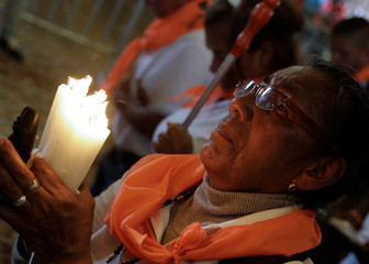 A Catholic completes the last steps on her knees inside the Basilica of Los Ange People to celebrate the apparition of the Virgin of Los Angeles in Cartago