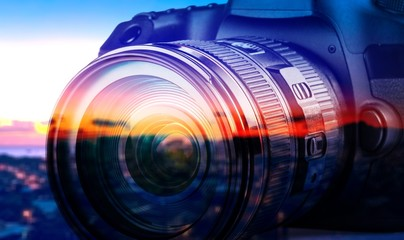 Professional camera on city background Wall mural