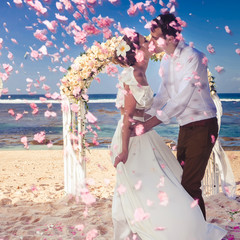 Wedding couple has just got married at the beach, Bali