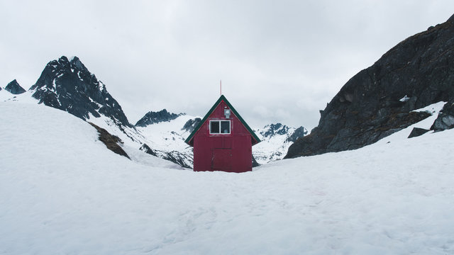 Red cabin in the Alaskan mountains.