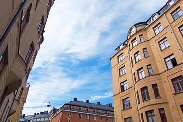 Tuinposter Scandinavië Vasastan typical century old buildings in yellow roughcast
