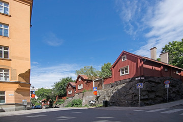 Old red wood homes in hills of Sodermalm
