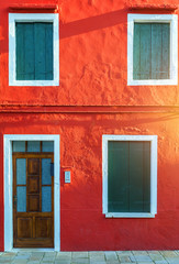 Colorful window of a house on the Venetian island of Burano, Venice. Facade of the houses of Burano close-up. Venice, Italy.