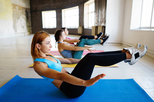 sporty women doing exercise in gym together
