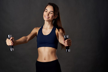 strong woman healthy lifestyle dumbbells sport fitness