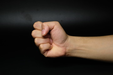 Man hand sign isolated on back background
