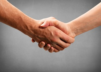 Business handshake on background
