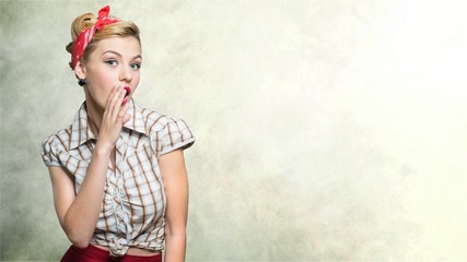Beautiful young woman with pin-up make-up