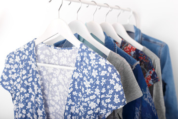 Wall Mural - Summer, autumn, spring clothes hanging on a rack, trending concept