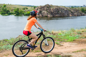 Young woman riding a mountain bike, an active lifestyle.