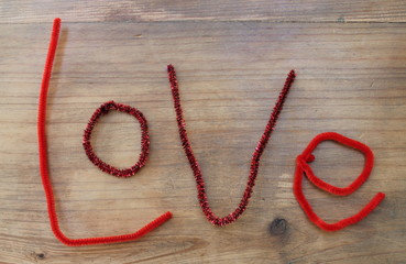 The word 'Love' spelled with craft pipe cleaners.