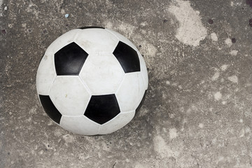Ball on the cement floor.